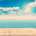 Wood tabletop and blurred sea with vintage tone Stock Photo