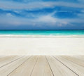 Wood Terrace on The Beach with Clear Sky, Blue Sea and Copyspace on White Sand for Mock up to Display Product or input Text Royalty Free Stock Photo