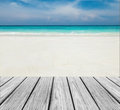 Wood Terrace on The Beach with Clear Sky,Blue Sea and White Sand to input Text Royalty Free Stock Photo