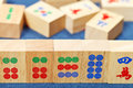Wood tiles closeup in mahjong game on blue cloth Stock Images