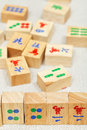 Wood tiles in mahjong game on textile table Royalty Free Stock Photos