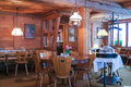 Wood trim and decorative lamps restaurant interior with Stock Image