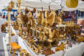 Woodcarver displaying Items For Sale Royalty Free Stock Photo
