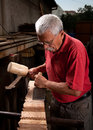 Woodcarver working with mallet and chisel Royalty Free Stock Photos