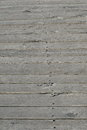 Woodden boards grey as background of a pathway all in with nails Stock Image