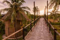 Wooded bridge and hut between sunrise in thailand Royalty Free Stock Images