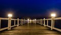 Wooded bridge in the port at night Stock Photography