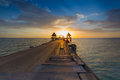 Wooded bridge in the port through the sea during sunset Stock Images