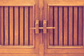 Wooded locked door woodned by wooden key stick Royalty Free Stock Photos