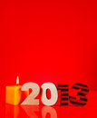 Wooden 2013 year number with a burning candle Royalty Free Stock Photos