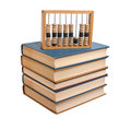 Wooden abacus on a pile of books Stock Photo