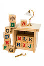 Wooden alphabet block with desk lamp and magnifying glass on white background Stock Photos