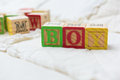 Wooden Alphabet Blocks on Quilt Spelling Boy Angled Royalty Free Stock Photo
