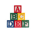 Wooden alphabet cubes with abc letters isolated Royalty Free Stock Photos