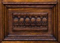 Wooden architectonic decoration this element made of wood is an inferior part of a door Royalty Free Stock Images