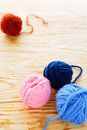 Wooden background with balls of wool knitting Royalty Free Stock Photo