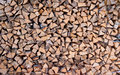 Wooden background of dry chopped firewood logs in a pile Stock Images