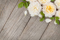 Wooden background with fresh rose flowers and copy space Royalty Free Stock Photos