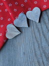 Wooden background with hearts fabric and Royalty Free Stock Image