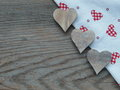 Wooden background with hearts fabric and Royalty Free Stock Photo