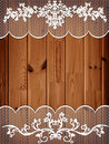 Wooden background with lace frame Royalty Free Stock Photos