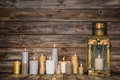 Wooden background in with many burning candles and a old rustic Royalty Free Stock Photo
