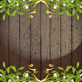 Wooden background with mistletoe borders Stock Photo