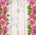 Wooden background with pink roses for your text Stock Images