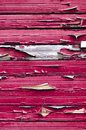 Wooden background with red peeling paint Royalty Free Stock Photo