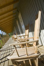 Wooden balcony on a resort jh with chairs during summer Stock Photography