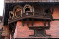 Wooden balcony and windows on the wall of king s palace in khatmandu Stock Images