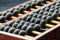 Wooden ball of abacus close up Stock Photography