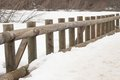 Wooden baluster bridge over lake Stock Image