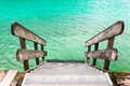 Wooden banister of the pier with water Royalty Free Stock Image