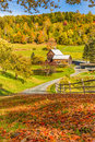 Wooden barn in fall foliage landscape in Vermont countryside Royalty Free Stock Photo