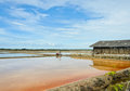 Wooden barn in salt ponds Stock Image