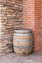 Wooden barrel and brick and stone walls Royalty Free Stock Photo