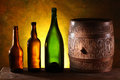 Wooden barrel colors bottles dark yellow background Stock Photos