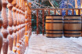 Wooden barrels and wood railing in snow Stock Photos