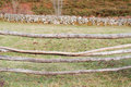 Wooden barrier in a rural field detail Royalty Free Stock Image