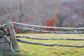 Wooden barrier in a rural field detail Stock Photos