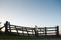Wooden barrier in a rural field sunset Royalty Free Stock Photos