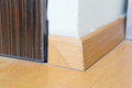 Wooden baseboard on corner Stock Photography