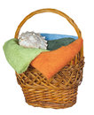 Wooden basket with towels and shell isolated on white background Royalty Free Stock Photo