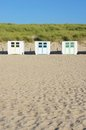 Wooden beach huts at the of texel the netherlands Stock Photos