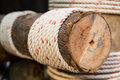Wooden beam wrapped with rope building construction and eco concept Royalty Free Stock Photos