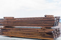 Wooden beams for framework stacked at construction site Royalty Free Stock Image