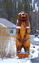 Wooden bear in snow Stock Images