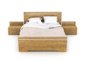 Wooden bed with linens. Royalty Free Stock Photo