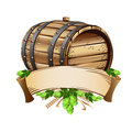 Wooden beer barrel and mug of beer